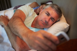 Couple In Bed With Husband Suffering From Insomnia